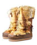 Furry winter boots. Isolated on white Royalty Free Stock Image