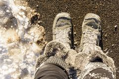Furry winter boots covered in snow. USA, Boston - Jaunary 2018 : Furry winter boots covered in snow royalty free stock photos