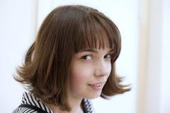 Furtive look. The girl artfully looks Royalty Free Stock Photo