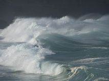 Fury. The fury of the ocean is displayed in the  force of its spray, which smothers every living thing Stock Photo