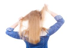 Furious woman pull hair out of head. Fury and big anger inside of people. Blonde furious woman pulling blonde hair out of head. Emotional young girl showing her Royalty Free Stock Images