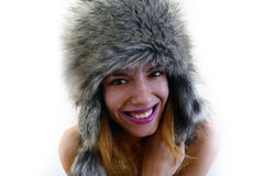 Fury hat. Portrait of a female wearing a fury, gray hat and pink lipstick stock photo