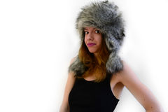 Fury hat. Portrait of a female wearing a fury, gray hat and pink lipstick royalty free stock photos