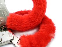 Fury red cuffs. Fury Red hand cuffs on white Stock Images