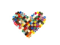 Fuse Beads Heart. A heart made of colorful fuse beads Royalty Free Stock Photo