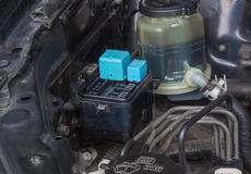 Fuse block and power steering fluid reservoir Stock Images