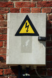 Fuse box. With black/yellow sign warning for risk of electrocution stock photos