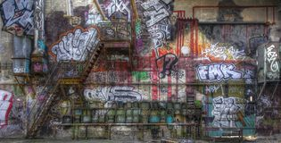 Fuse box. Graffiti and a staircase on a wall stock image