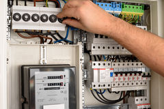 Fuse box. Men working in a Fuse box stock photos
