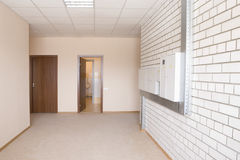 Fusebox In Wide Hallway. Tiled wall with fusebox in wide hallway Royalty Free Stock Photography