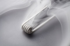 Fused clapton coil for vaping on a black background smoke Royalty Free Stock Photography