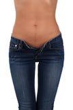 Fuselage d'une jeune femme dans des jeans Photographie stock