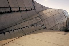 Fuselage detail view. Airplane metallic fuselage detail with rivets. Old silver metal surface of the aircraft fuselage Royalty Free Stock Image