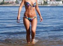 Fuselage femelle bronzé Photo stock