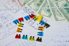 Fuses and money on construction drawings Stock Image