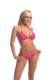 Fusha Bikini Blond. Sexy blond swimwear model in a fusha sequine embellished bikini. Thumb hooked in band of bottoms Royalty Free Stock Images