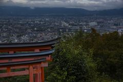 Fushimi inari red torii gate with top view of Kyoto city Stock Photo