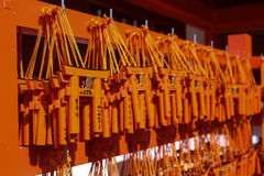 Fushimi Inari Shrine in Kyoto Japan. KYOTO, JAPAN - APRIL 11, 2016 : Ema prayer tables with unique Torii gates boards at Fushimi Inari Taisha Temple in Kyoto Stock Photos