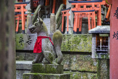 Fushimi Inari shrine in Kyoto, Japan. Fox statue in Fushimi Inari shrine in Kyoto, Japan Royalty Free Stock Image