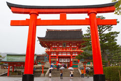 Fushimi Inari Shrine, Kyoto, Japan. KYOTO, JAPAN - MARCH 18: A giant torii gate in front of the Romon Gate at Fushimi Inari Shrine's entrance on March 18, 2013 Royalty Free Stock Photo