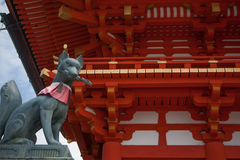 Fushimi Inari Shrine. Statue of the fox-like deity Inari near the main hall of the Shinto shrine of Fushimi Inari-taisha, in Kyoto, Honshu Island, Japan Stock Photography