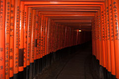 Tunnel thru the gates at Fushimi Inari Shrine Royalty Free Stock Photography