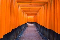 Fushimi Inari Taisha Shrine, the famous down line bright orange Royalty Free Stock Photos
