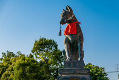 Fushimi Inari Taisha Shrine. Kyoto, Japan - May 4, 2016: Fox sculpture in Fushimi Inari-taisha shrine. Fushimi Inari Taisha is the head shrine of Inari, located Royalty Free Stock Photos