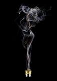 Fusible enflé avec de la fumée féminine sur le fond noir image stock