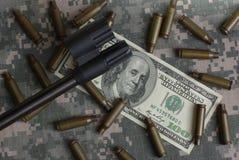 Fusil, argent et interpréteurs de commandes interactifs Photographie stock