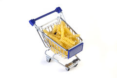 Fusili. In shopping cart on white background royalty free stock photography
