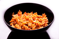 Pasta with tomato sauce. Fusili pasta with tomato sauce and parmigiano cheese royalty free stock photo