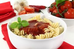 Fusilli. Cooked pasta with tomato sauce and basil Stock Images