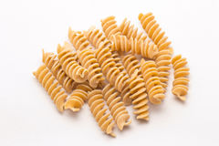 Fusilli. Whole wheat pasta on white background Royalty Free Stock Photography