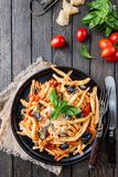 Fusilli al ferro pasta. With tomato sauce, tomatoes, eggplant, onion and pepper on a plate. Top view stock photos