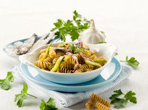 Fusilli with anchovies Royalty Free Stock Photography