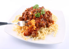 Fusilli bolognese. Fusilli bucati lunghi with bolognese sauce being eaten with a fork stock photos