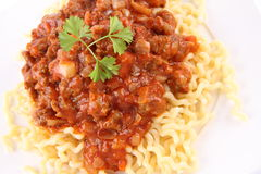Fusilli bolognese. Fusilli bucati lunghi with bolognese sauce on a plate stock photo