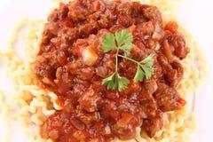 Fusilli bolognese. Fusilli bucati lunghi with bolognese sauce on a plate stock image