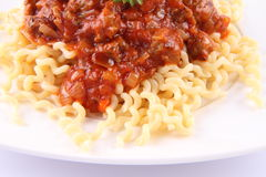 Fusilli bolognese. Fusilli bucati lunghi with bolognese sauce on a plate royalty free stock images