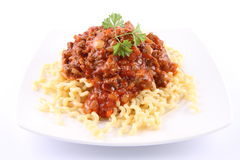 Fusilli bolognese. Fusilli bucati lunghi with bolognese sauce on a plate stock photography