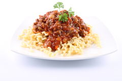 Fusilli bolognese. Fusilli with bolognese sauce on a plate royalty free stock photos