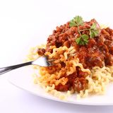 Fusilli bolognese. Fusilli bucati lunghi with bolognese sauce being eaten with a fork royalty free stock photos