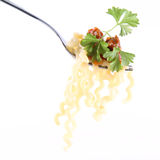 Fusilli bolognese on a fork. Fusilli bolognese decorated with parsley on a fork stock photos