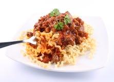 Fusilli with bolognese sauce. Fusilli bucati lunghi with bolognese sauce on a plate royalty free stock image