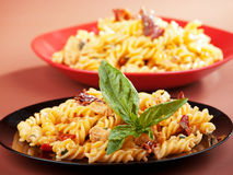 Fusilli with chicken and dried tomatoes Royalty Free Stock Images