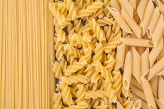 Fusilli dry pasta background concept. Stock Photo