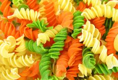Fusilli green, orange and yellow Stock Photography