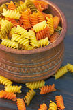 Fusilli italian pasta in wood bowl Royalty Free Stock Photography
