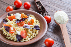 Fusilli lunghi with cheese and cherry tomatoes Stock Photos